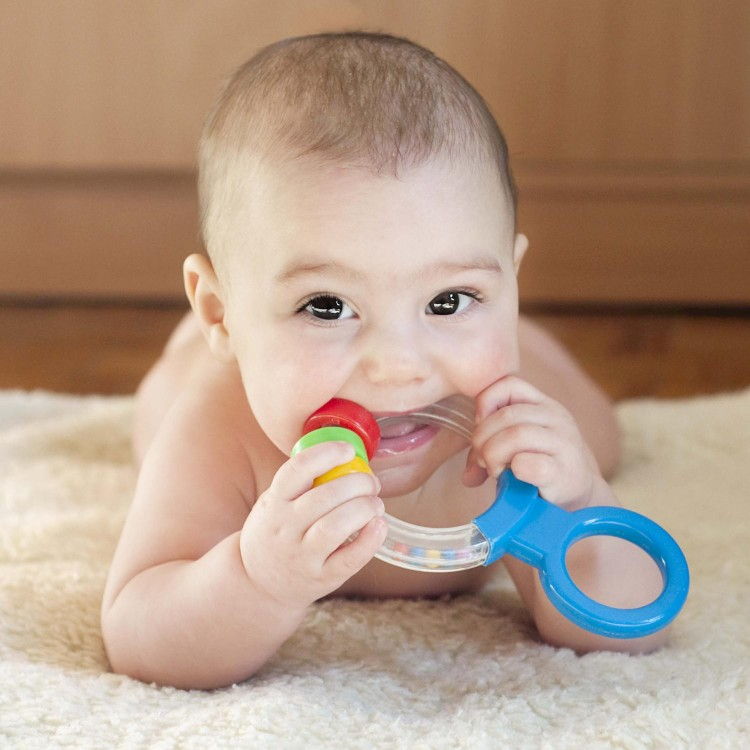 Babies will mouth toys as they explore their environment, this is a form of play.